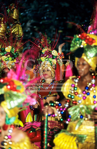 Rio de Janeiro, Brazil. Carnival samba school parade; women in bright, multicoloured ornate costumes.