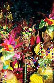 Rio de Janeiro, Brazil. Carnival samba school parade; women in bright, multicoloured ornate costumes.