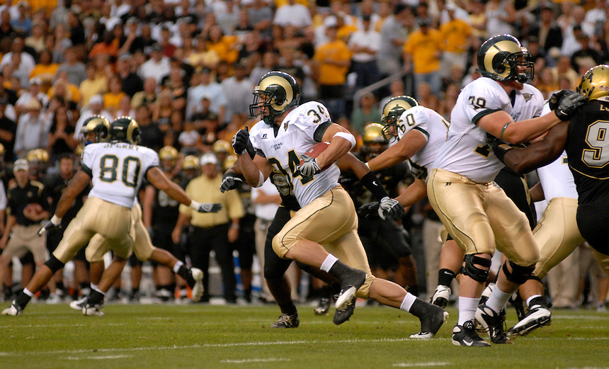 31 Aug 2008: Colorado State running back Kyle Bell (34) carries the ball against Colorado. The Colorado Buffaloes defeated the Colorado State Rams 38-17 at Invesco Field at Mile High in Denver, Colorado. FOR EDITORIAL USE ONLY