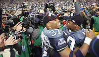 Seahawks Shaun Alexander, left congratulates teammate Cornelius Wortham, right, in front of the news media after defeating the Carolina Panthers in the NFC Championship game at Qwest Field in Seattle. Washington on January 22, 2006.