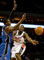 Charlotte Bobcats guard Raymond Felton (20) passes the ball around the Orlando Magic during an NBA basketball game  at Time Warner Cable Arena in Charlotte, NC.