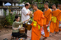 Buddhist Monks receiving alms at Luang Prabang,Laos