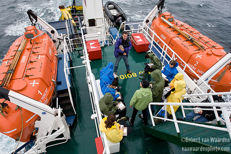 A study in colour keeps an art class busy on the aft deck. Cape Farewell Youth Expedition 08.(©Robert vanWaarden ALL RIGHTS RESERVED)