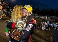 Nov 16, 2014; Pomona, CA, USA; NHRA top fuel driver Morgan Lucas (right) celebrates with wife Katie Lucas after winning the Auto Club Finals at Auto Club Raceway at Pomona. Mandatory Credit: Mark J. Rebilas-USA TODAY Sports