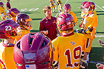 Rancho Santa Margarita, CA 04/30/10 - A Torrey Pines coach addresses game strategy with his players before the game