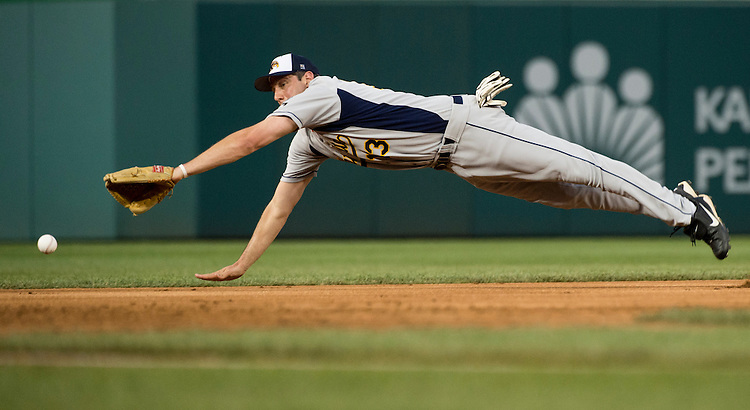 UNITED STATES - JUNE 25: Short stop Rep. Tim Ryan, D-Ohio, dives for a ground ball during the Roll Call Congressional Baseball Game on Wednesday, June 25, 2014. (Photo By Bill Clark/CQ Roll Call)