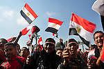 Egyptians celebrate and wave national flags in Tahrir Square in Cairo, Egypt, Saturday, Feb. 12, 2011. Egypt exploded with joy, tears, and relief after pro-democracy protesters brought down President Hosni Mubarak with a momentous march on his palaces and state TV. Mubarak, who until the end seemed unable to grasp the depth of resentment over his three decades of authoritarian rule, finally resigned Friday and handed power to the military. Photo by Ahmed Asad