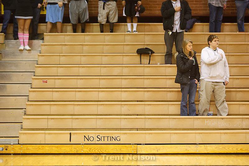 Trent Nelson  |  The Salt Lake Tribune.National anthem, no sitting sign, at Highland vs. Riverton High School basketball in Salt Lake City, Utah, Friday, December 2, 2011.