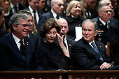 Former Florida Gov. Jeb Bush, Laura Bush and former President George W. Bush listen during a State Funeral for former President George H.W. Bush at the Washington National Cathedral, Wednesday, Dec. 5, 2018, in Washington.<br /> Credit: Alex Brandon / Pool via CNP