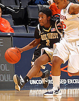 Feb. 3, 2011; Charlottesville, VA, USA; Wake Forest Demon Deacons guard Brooke Thomas (1) drives past Virginia Cavaliers forward/center Erinn Thompson (5) during the game at the John Paul Jones Arena.  Mandatory Credit: Andrew Shurtleff