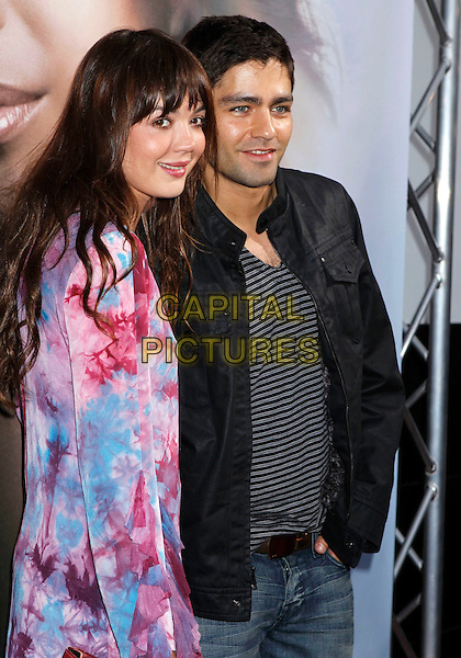 "GUEST & ADRIAN GRENIER.""Eva"" by Eva Longoria Fragrance Launch Event held at at Beso Hollywood, Hollywood, California, USA..April 27th, 2010.perfume half length black grey gray stripe jacket top blue pink floral print dress .CAP/ADM/MJ.©Michael Jade/AdMedia/Capital Pictures."