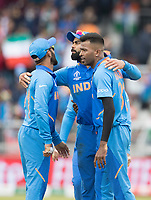 Dinesh Karthik (India), Hardik Pandya (India) and Virat Kolli (India) celebrate the wicket of Neesham during India vs New Zealand, ICC World Cup Semi-Final Cricket at Old Trafford on 9th July 2019