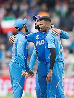Dinesh Karthik (India), Hardik Pandya (India) and Virat Kolli (India) celebrate the wicket of Neesham during India vs New Zealand, ICC World Cup Semi-Final Cricket at Old Trafford on 9th July 2019