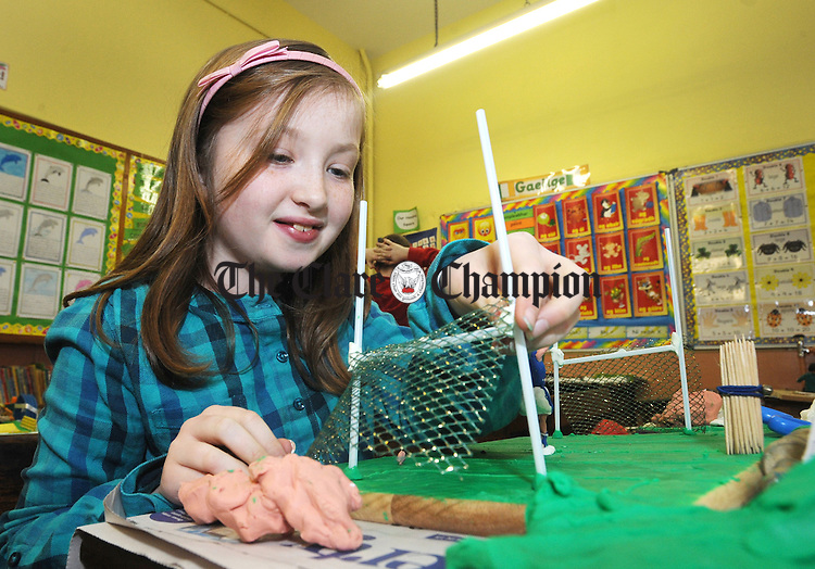 Ciara O' Brien from Cratloe working on a football pitch during the Community Games Art and Model Making County Finals held at Ennis CBS over the weekend. Photograph by Declan Monaghan