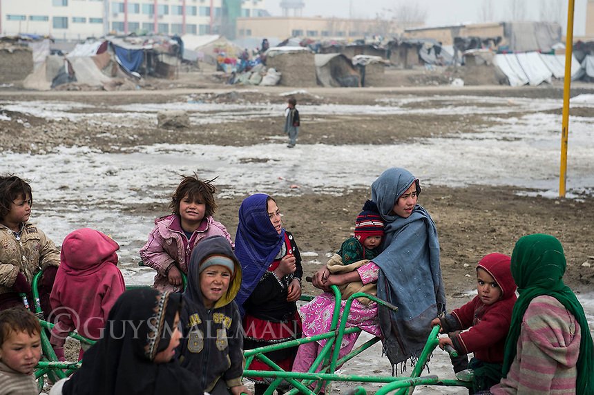 The Darulaman refugee camp in Kabul for poor and displaced people. They had mostly returned to Afghanistan from exile in Pakistan to find themselves homeless and destitute. 8-1-13