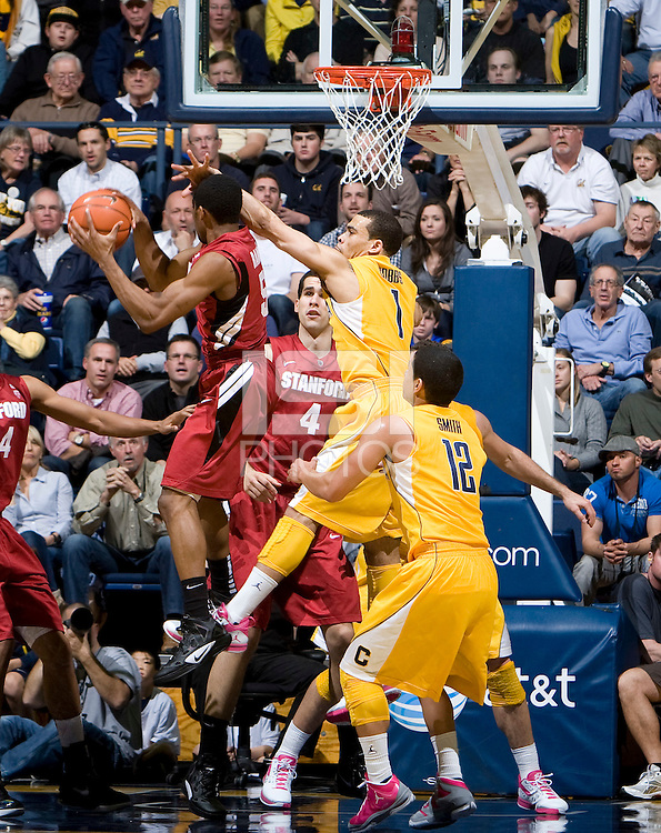 Justin Cobbs of California tries to block Stanford's Chasson Randle's shot during the game against Stanford at Haas Pavilion in Berkeley, California on January  29th, 2012.   California defeated Stanford, 69-59.