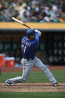 OAKLAND, CA - AUGUST 22:  Robinson Chirinos #61 of the Texas Rangers bats during the game against the Oakland Athletics at the Oakland Coliseum on Wednesday, August 22, 2018 in Oakland, California. (Photo by Brad Mangin)