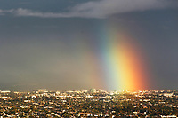 Dec. 16, 2014_San Diego_ California_USA_| A rainbow lands in Kearny Mesa during an afternoon rain, seen from Mt. Soledad.  |_Mandatory Photo Credit: Photo by K.C. Alfred/UT San Diego/Copyright 2014