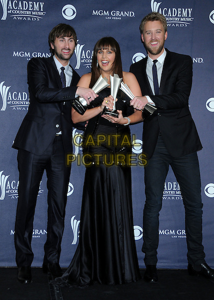 LADY ANTEBELLUM - Dave Haywood, Hillary Scott and Charles Kelley .46th Annual Academy of Country Music Awards - Press Room held at the MGM Grand Garden Arena, Las Vegas, NV, USA..April 3rd, 2011.award winner winners trophy trophies black suit dress full length.CAP/ADM/BP.©Byron Purvis/AdMedia/Capital Pictures.