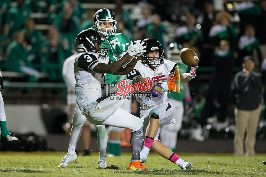 Marquill Osborne (3) and Zack Dudan (10) of the Hough Huskies break up a pass against the A.L. Brown Wonders during second half action at A.L. Brown High School on October 16, 2015 in Kannapolis, North Carolina.  The Huskies defeated the Wonders 21-7.  (Brian Westerholt/Sports On Film)