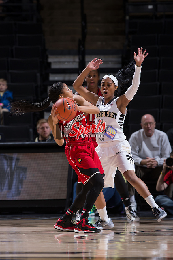 Arica Carter (11) of the Louisville Cardinals is guarded by Mykia Jones (4) of the Wake Forest Demon Deacons during first half action at the LJVM Coliseum on January 11, 2015 in Winston-Salem, North Carolina.  The Cardinals defeated the Demon Deacons 79-68.  (Brian Westerholt/Sports On Film)