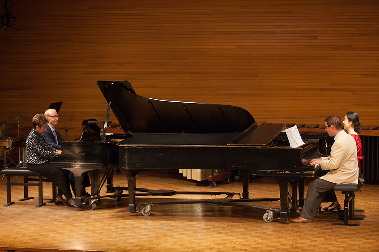 Gail Berenson, Professor Emeritus of Piano Performance, and Christopher Fisher, Professor of Piano, Sean Parsons, Assistant Professor of Jazz Studies and Music Theory, and Youmee Kim, Assistant Professor of Piano, play Hungarian Dance No. 5 in F-sharp in Glidden Hall during the Faculty and Alumni Centennial Chamber Music Recital on Friday, April 21, 2017. © Ohio University / Photo by Kaitlin Owens