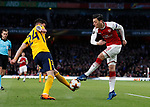 Arsenal's Mesut Ozil tussles with Atletico's Jose Maria Gimenez during the Europa League Semi Final 1st Leg, match at the Emirates Stadium, London. Picture date: 26th April 2018. Picture credit should read: David Klein/Sportimage