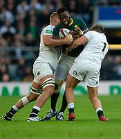 South Africa's Siya Kolisi is tackled by England's Alec Hepburn<br /> <br /> Photographer Bob Bradford/CameraSport<br /> <br /> Quilter Internationals - England v South Africa - Saturday 3rd November 2018 - Twickenham Stadium - London<br /> <br /> World Copyright &copy; 2018 CameraSport. All rights reserved. 43 Linden Ave. Countesthorpe. Leicester. England. LE8 5PG - Tel: +44 (0) 116 277 4147 - admin@camerasport.com - www.camerasport.com