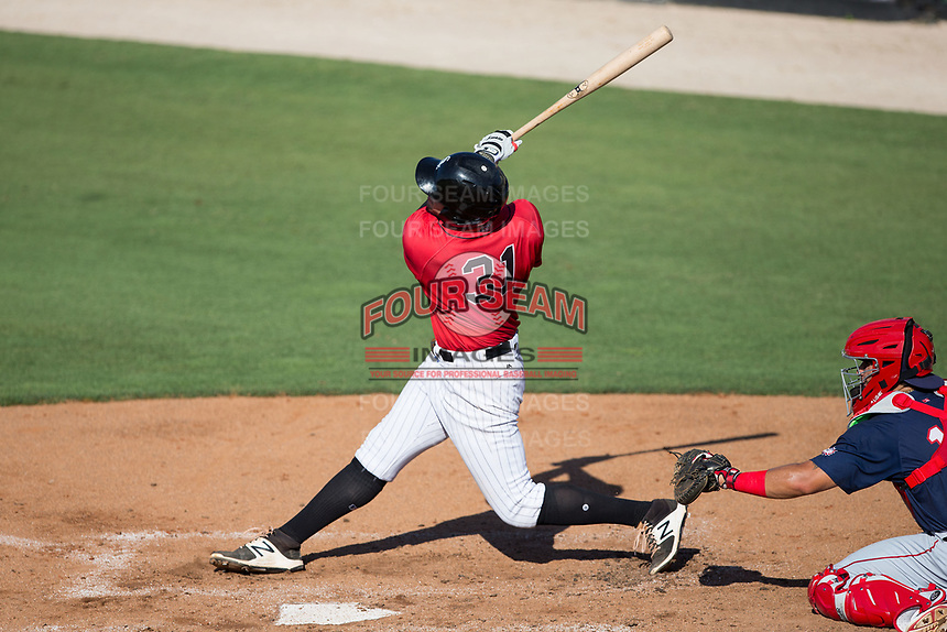 Brandon Dulin (31) of the Kannapolis Intimidators follows through on his swing against the Hagerstown Suns at Kannapolis Intimidators Stadium on June 14, 2017 in Kannapolis, North Carolina.  The Intimidators defeated the Suns 4-1 in game one of a double-header.  (Brian Westerholt/Four Seam Images)