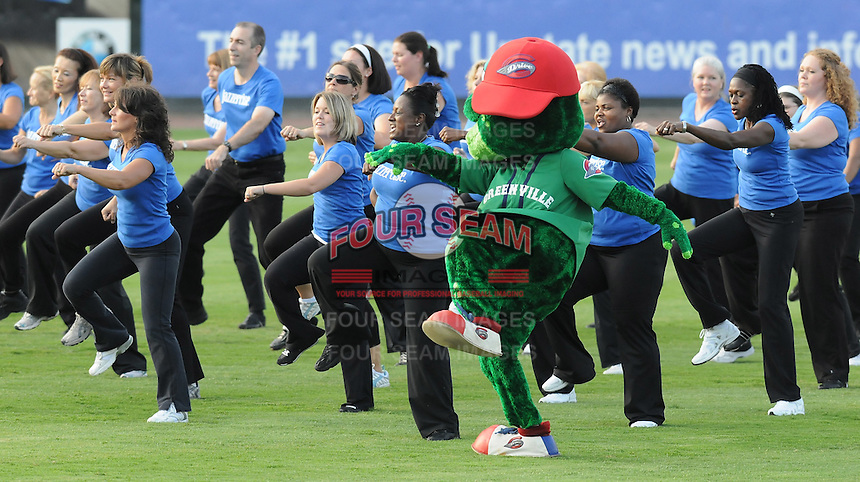 """August 13, 2009: Greenville Drive mascot Reedy Rip'It dances with a local dance group from """"Jazzercise"""" before a game at Fluor Field at the West End in Greenville, S.C. Photo by: Tom Priddy/Four Seam Images"""