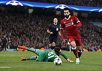 Liverpool's Mohamed Salah rounds Manchester City's Ederson to score his side's equalising goal to make the score 1 - 1<br /> <br /> Photographer Rich Linley/CameraSport<br /> <br /> UEFA Champions League Quarter-Final Second Leg - Manchester City v Liverpool - Tuesday 10th April 2018 - The Etihad - Manchester<br />  <br /> World Copyright &copy; 2017 CameraSport. All rights reserved. 43 Linden Ave. Countesthorpe. Leicester. England. LE8 5PG - Tel: +44 (0) 116 277 4147 - admin@camerasport.com - www.camerasport.com