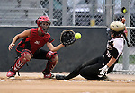 SIOUX FALLS, SD - JULY 7:  Sarah Kubes #18 of the Shopokee Stealth waits for the ball as Shannon Petersen #30 from the Minnesota Renegades slides safely into home in the first inning of their 2013 Ringneck Softball tournament U16 Championship game Sunday evening at Sherman Park. (Photo by Dave Eggen/Inertia)
