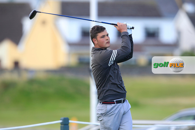 Stuart Bleakley (Shandon Park) on the 1st tee during Matchplay Round 3 of the South of Ireland Amateur Open Championship at LaHinch Golf Club on Saturday 25th July 2015.<br /> Picture:  Golffile | TJ Caffrey