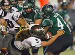 Torrance, CA 10/09/15 - Sean Humphrey (South #72), Cameron Dillon (South #44) and Tyler Maseuli (Torrance #5) in action during the Torrance vs South High varsity football game.  South defeated Torrance 24-21.