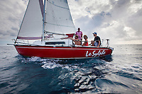 Day sailors aboard small red boat called Le Sylphe