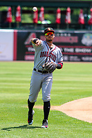 Quad Cities River Bandits shortstop Miguelangel Sierra (4) warms up in the outfield prior to a Midwest League game against the Kane County Cougars on July 1, 2018 at Northwestern Medicine Field in Geneva, Illinois. Quad Cities defeated Kane County 3-2. (Brad Krause/Four Seam Images)