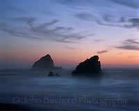 Rocks at dawn with a misty pacific Ocean, Mendocino California
