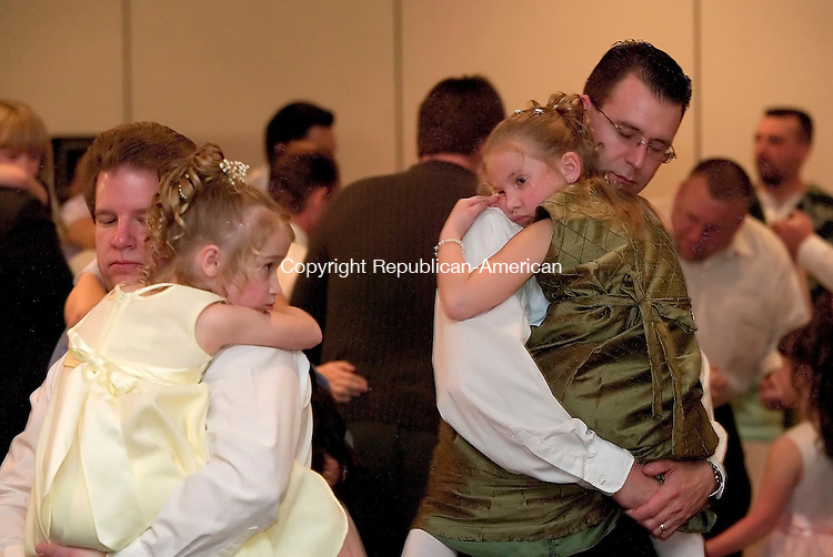 WATERBURY, CT- 09 APRIL 2005-041005J01--Tarp Young, left, dances with his daughter Hailey, 6 while Todd Burton, right, dances with his daughter Sarah, 6, during the Girl Scouts in Wolcott's annual Me and My Beau Dance held Sunday at the Pontelandolfo Club in Watrbury.   --- Jim Shannon Photo--Pontelandolfo Club; Tarp Young; Hailey Young; Todd Burton; Sarah Burton; Girl Scouts; Wolcott are CQ