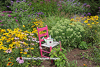 63821-23012 Pink chair and watering can birdhouse in flower garden, Marion Co., IL