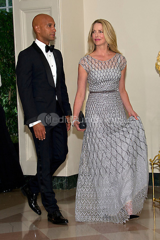 Laurene Powell Jobs, Founder, Emerson Collective, and former Mayor Adrian Fenty (Democrat of Washington, DC) arrive for the State Dinner honoring Prime Minister Lee Hsien Loong of the Republic of Singapore at the White House in Washington, DC on Tuesday, August 2, 2016.<br /> Credit: Ron Sachs / Pool via CNP/MediaPunch
