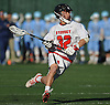 Michael Elardo #32 of Syosset races downfield during a Nassau County varsity boys lacrosse game against Oceanside at Syosset-Woodbury Community Park on Tuesday, Apr. 12, 2016. Syosset won by a score of 18-4.
