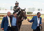 HALLANDALE BEACH, FL - March 31: Owners Rick Pitino, Roddy Valente, and Terry Finley of West Point Thoroughbreds celebrate with jockey Luis Saez on his win aboard Coach Rocks for Trainer Dale Romans after the Gulfstream Park Oaks at Gulfstream Park on March 31, 2018 in Hallandale Beach, FL. (Photo by Carson Dennis/Eclipse Sportswire/Getty Images.)