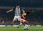 Arsenal's Mohamed Elneny tussles with West Brom's Gareth Barry during the premier league match at the Emirates Stadium, London. Picture date 25th September 2017. Picture credit should read: David Klein/Sportimage