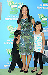 WESTWOOD, CA. - November 14: Ming Na and her children arrive to the Los Angeles premiere of 'Planet 51' at the Mann Village Theatre on November 14, 2009 in Westwood, California.