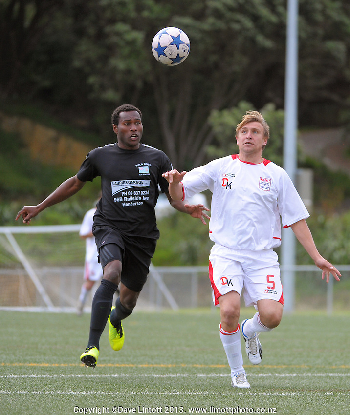 Action from the match between Poland (white and red) and Bula Boys during the 2013 NZ Communities Cup football tournament at Wakefield Park,  Wellington, New Zealand, on Saturday, 30 November 2013. Photo: Dave Lintott / lintottphoto.co.nz