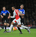 Arsenal's Theo Walcott tussles with Bournemouth's Andrew Surman<br /> <br /> Barclays Premier League- Arsenal vs AFC Bournemouth - Emirates Stadium - England - 28th December 2015 - Picture - David Klein/Sportimage