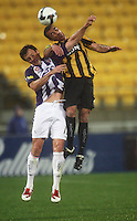 Phoenix' Manny Muscat beats Todd Howart to a header during the A-League football match between Wellington Phoenix and Perth Glory at Westpac Stadium, Wellington, New Zealand on Sunday, 16 August 2009. Photo: Dave Lintott / lintottphoto.co.nz