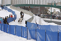 Saturday March 6 , 2010  Peter Kaiser makes his way on the trail alongside Tudor road after crossing the Tudor Road bridge     during the ceremonial start of the 2010 Iditarod in Anchorage , Alaska