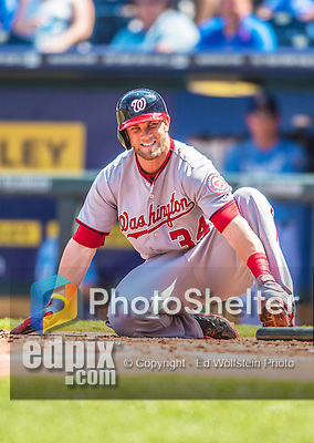 25 August 2013: Washington Nationals outfielder Bryce Harper sits in pain at home plate after fouling a ball onto his left foot during a game against the Kansas City Royals at Kauffman Stadium in Kansas City, MO. The Royals defeated the Nationals 6-4, to take the final game of their 3-game inter-league series. Mandatory Credit: Ed Wolfstein Photo *** RAW (NEF) Image File Available ***