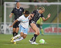 Allie Long #9 of the Washington Freedom shields the ball from Cristiane #11 of the Chicago Red Stars during a WPS match at the Maryland Soccerplex, in Boyds Maryland on June 12 2010. The game ended in a 2-2 tie.